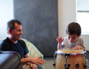 Young boy received drumming lessons