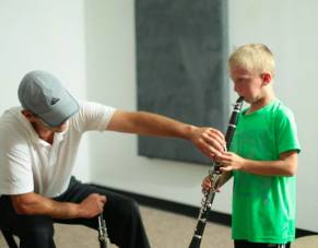 Young boy receives clarinet lessons