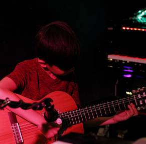 Young guitar student performing